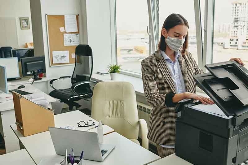 Ephesus Office Technologies woman at coipier